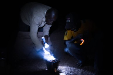 Lighting the smoker before visiting beehives in Burkina Faso. Picture: A. Aebi